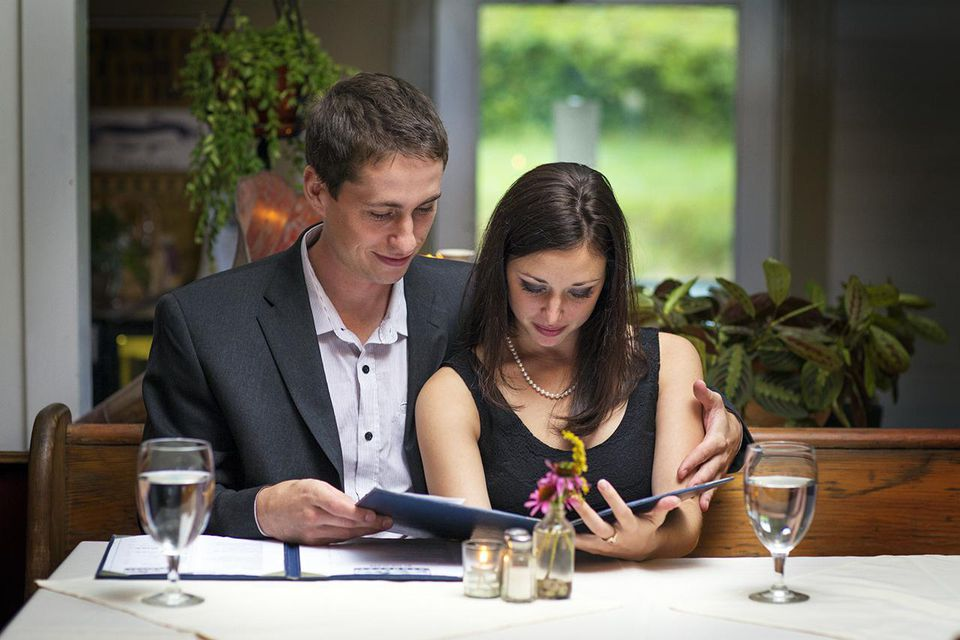 Young Couple Looking at Menu at a Fine Restaurant