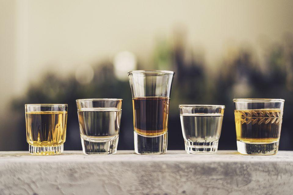 Shot glasses full of different alcohols