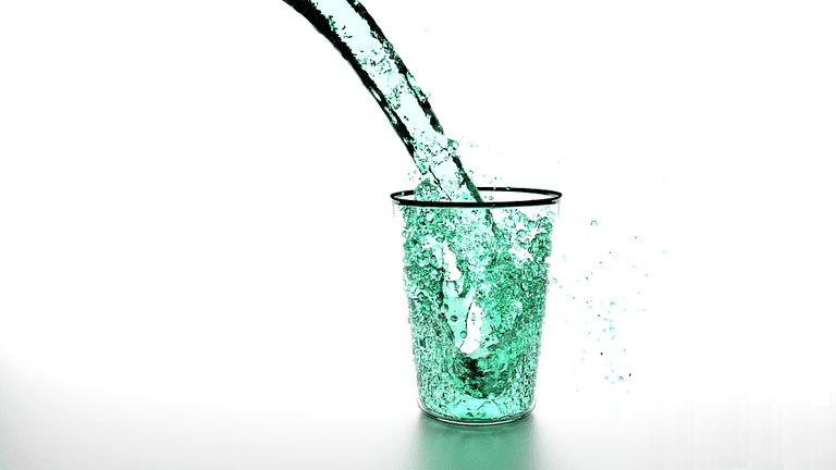 liquid being poured into cup
