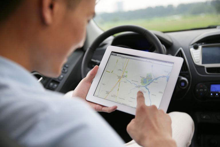 man using wifi in car