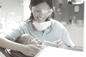female dental assistant working on boy