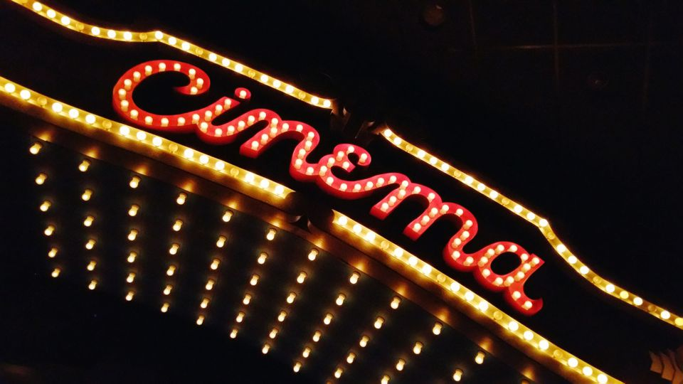 Cinema on marquee at movie house.