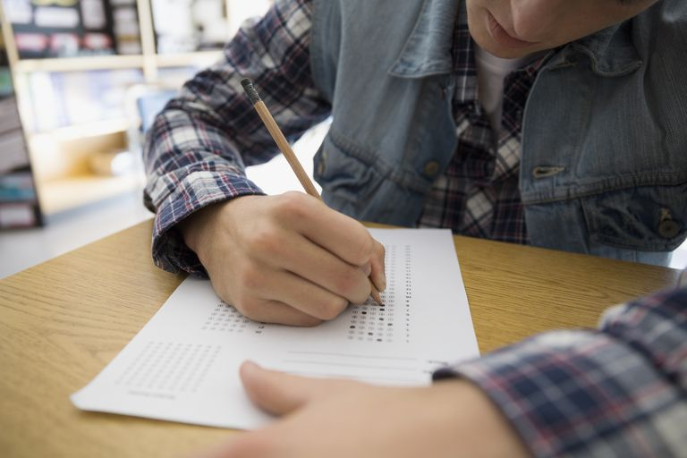 High school student completing multiple choice test form