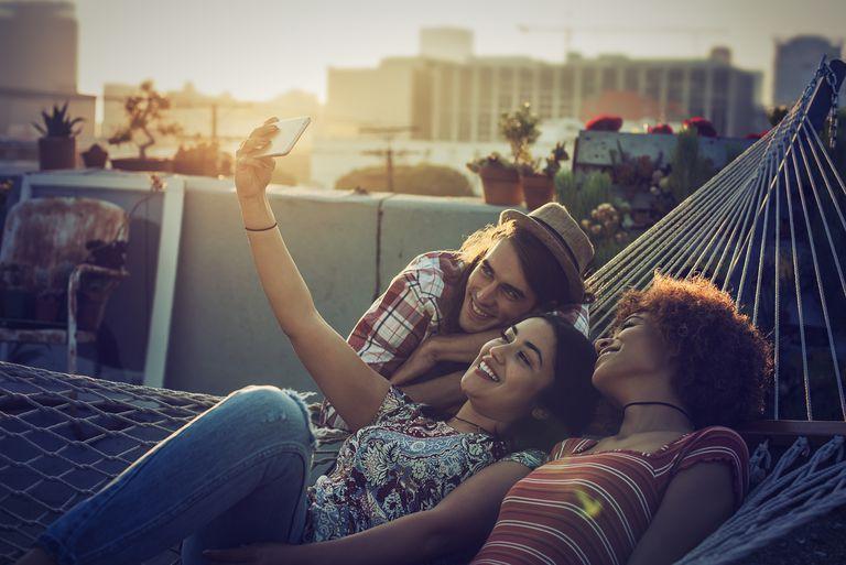 Friends taking a selfie on urban rooftop