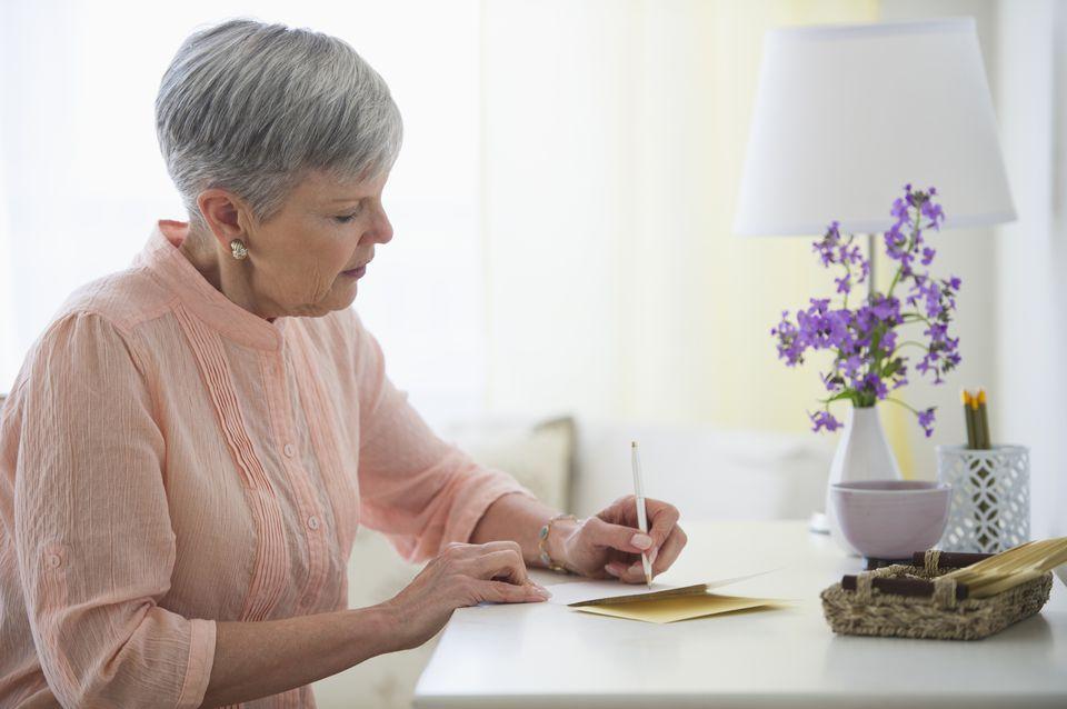 Woman writing sympathy letter