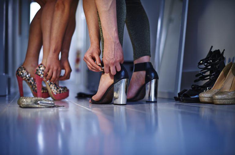 Women putting on stilettos