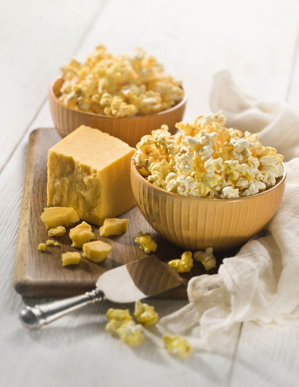 Bowls of cheese flavored popcorn