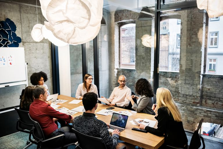 A group of young people in a business meeting.