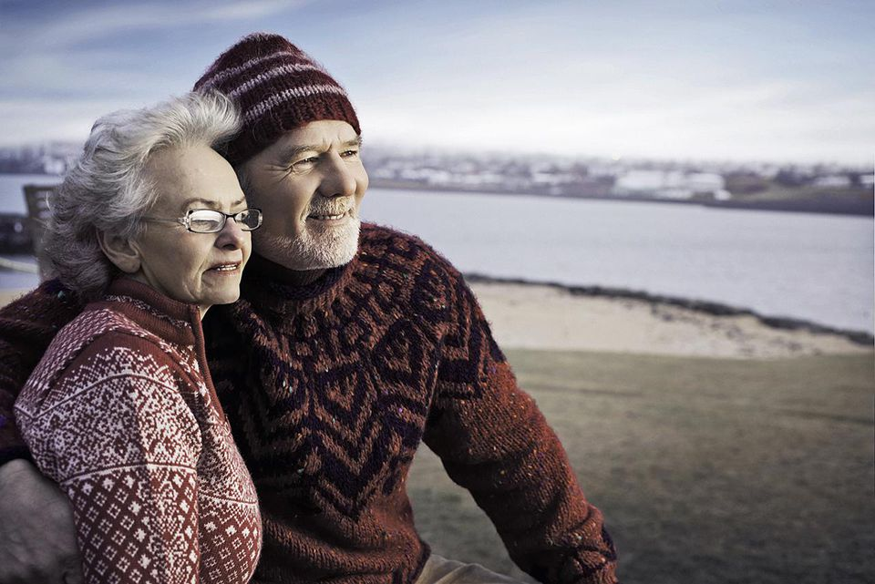 Older couple hugging on beach