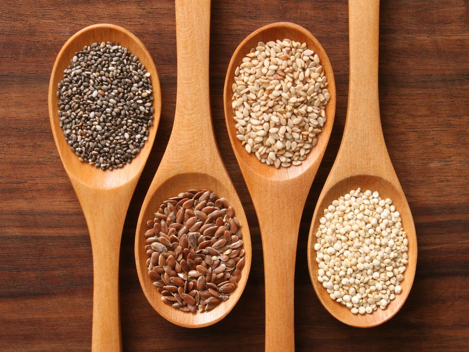 healthy edible seeds on wooden spoons