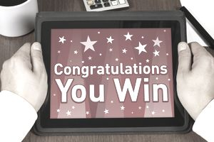 """Image of a Tablet Computer Reading """"Congratulations You Win"""""""