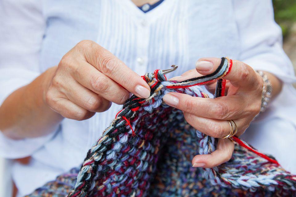 women hands crochet woolen carpet