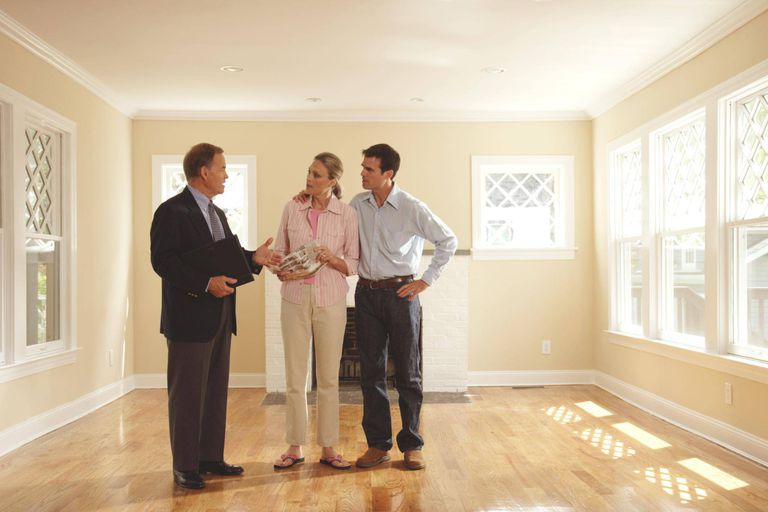 Couple meeting with realtor in house for sale