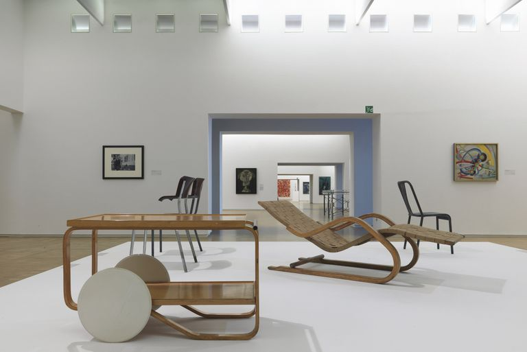 A cart and lounge chairs by Alvar Aalto on display at the Pompidou Center in Paris