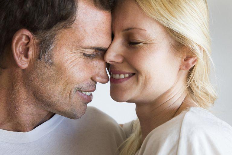 Couple in romantic embrace, smiling joyfully