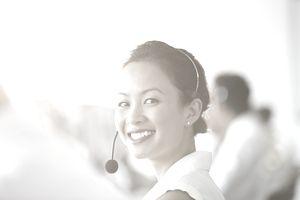 Asian Businesswoman wearing headset in office
