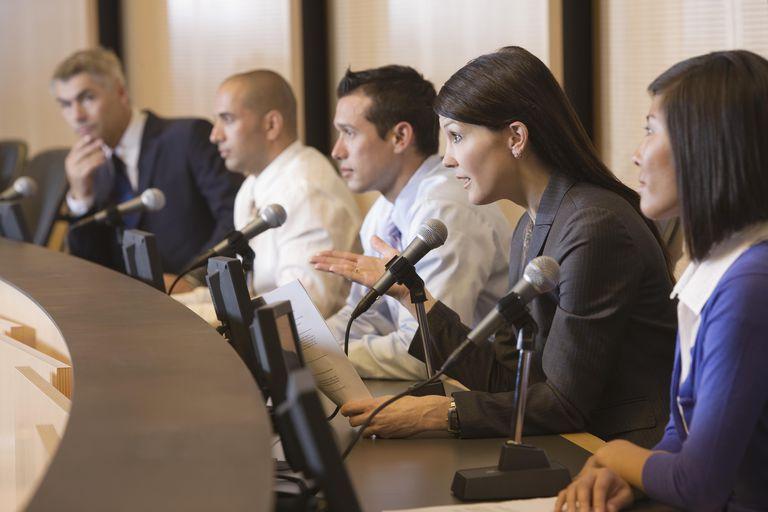 Female speaker at mic in public forum