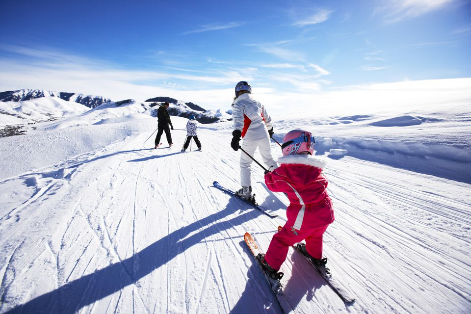 Family skiing, rear view
