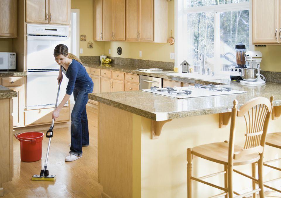 Girl mopping kitchen floor