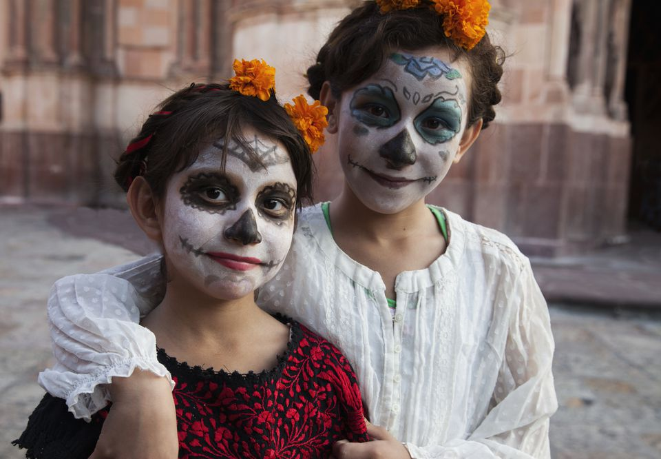 Mexican children show day of the dead traditions that you can share with grandchildren.
