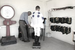 Clerk of Scales records weight of a jockey on race day