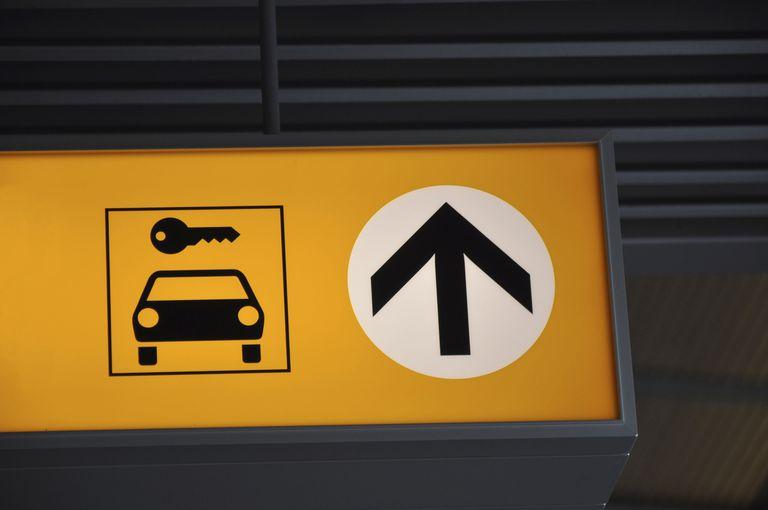 Yellow and black car rental sign