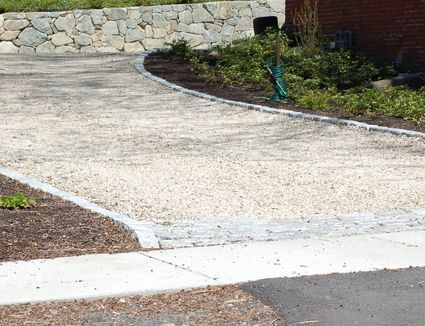 Pros and cons of a tar and chip driveway what kind of driveway should you have installed solutioingenieria Image collections