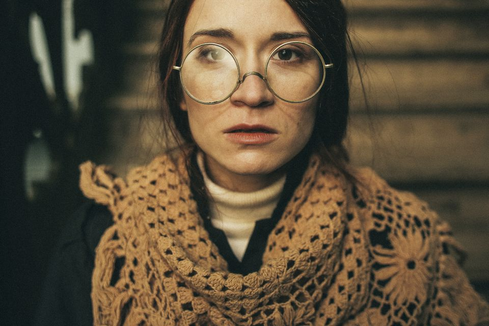 Caucasian woman wearing crocheted cover and eyeglasses