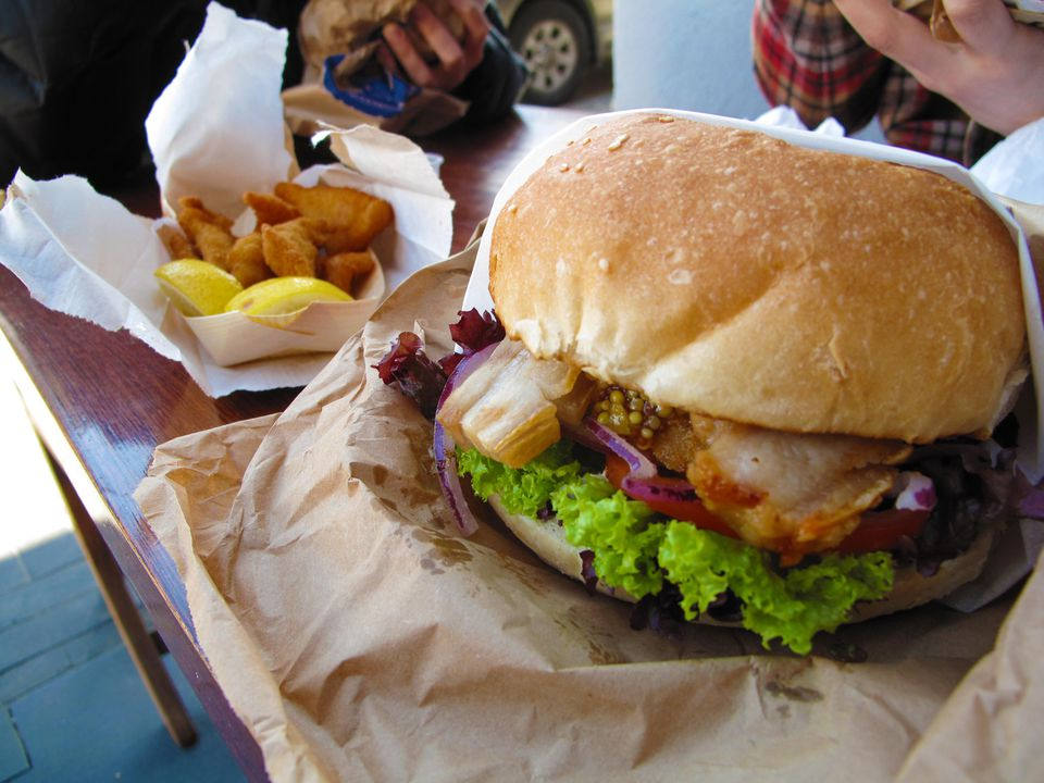 The 'Chief Wiggum', Fergburger Slow roasted pork belly, lettuce, tomato, red onion, hash brown, with aioli and a delicious apricot seeded mustard