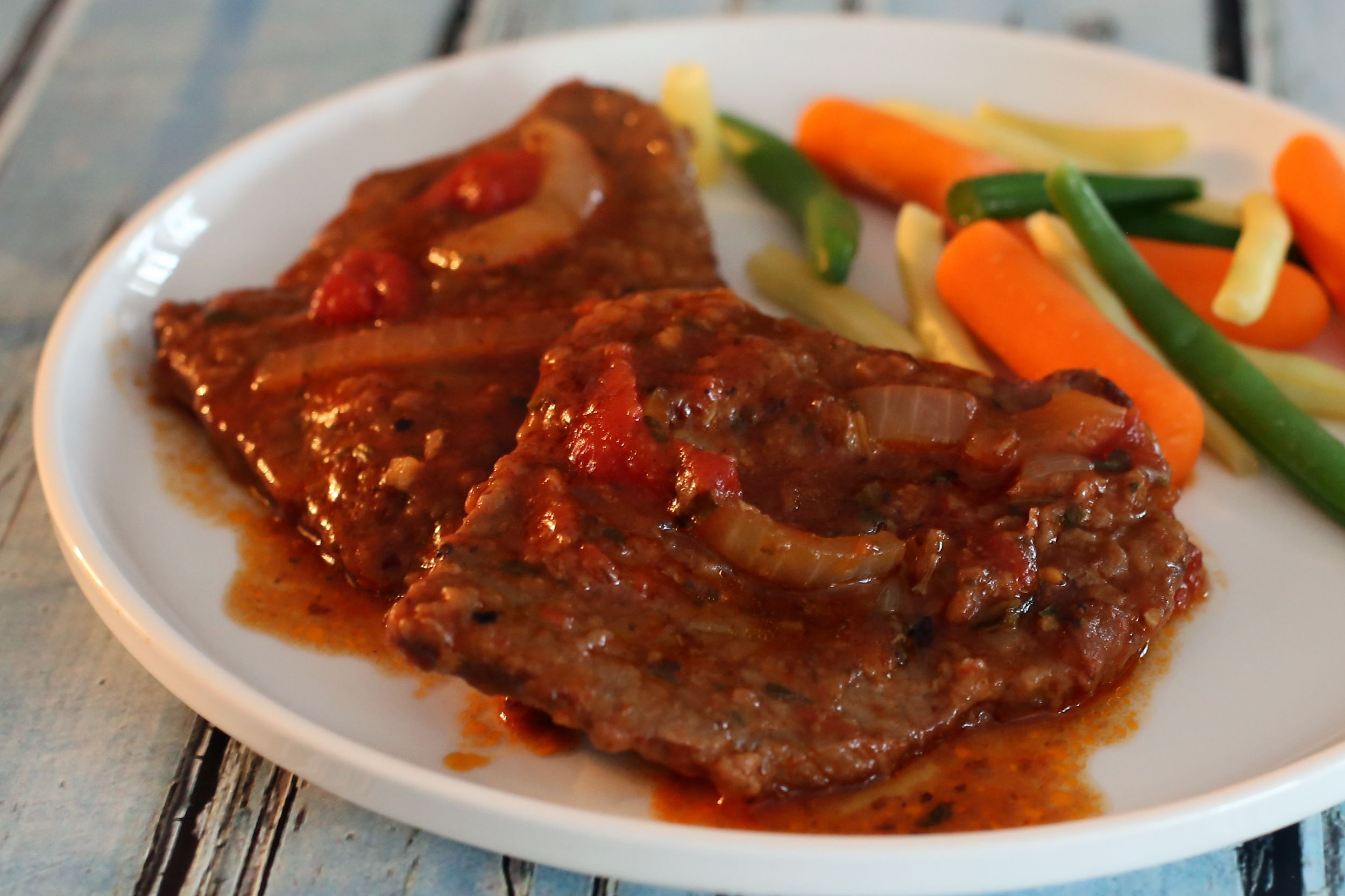 Swiss Steak with Round Steak and Stewed Tomatoes Recipe