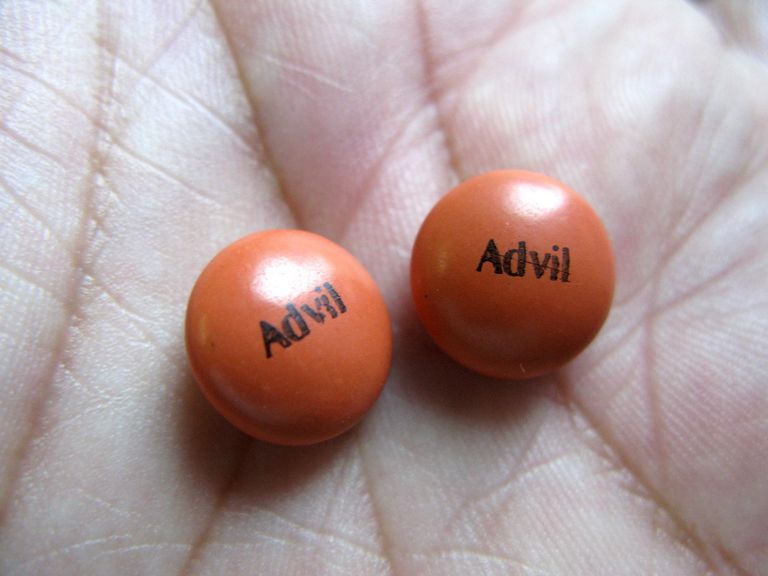 Advil in palm of hand