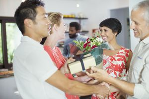 Couple exhanging gift at party