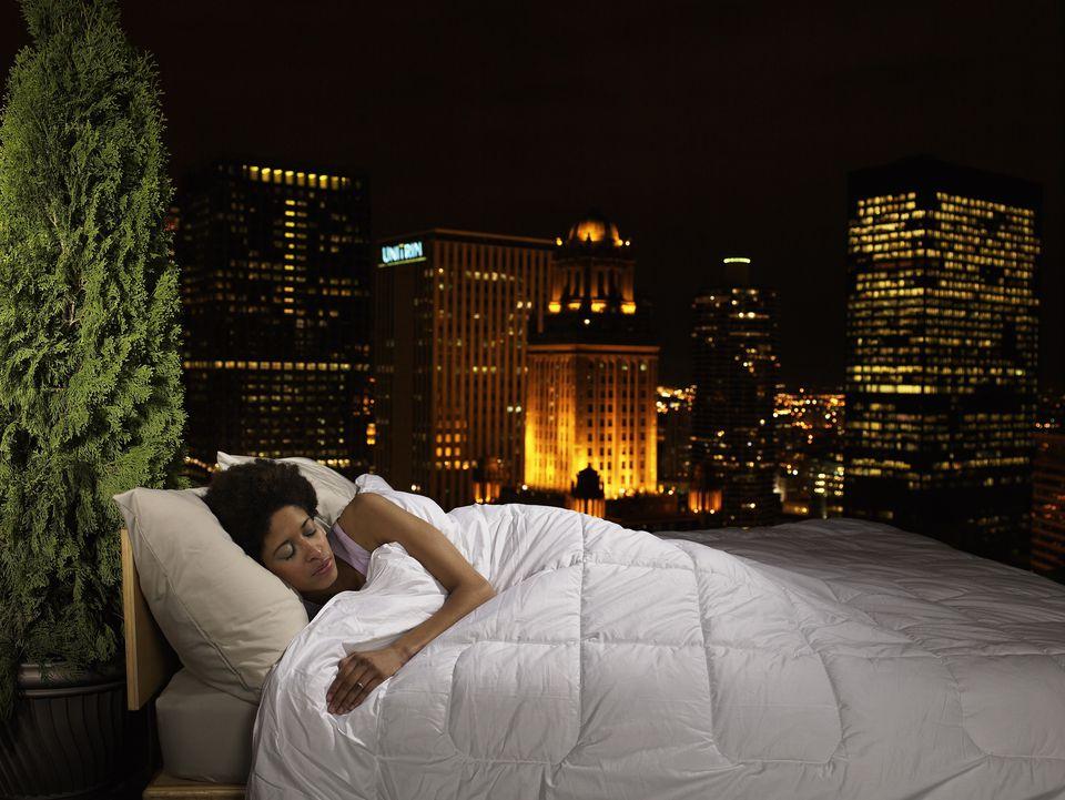 woman sleeping on rooftop
