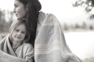 Mother and daughter thinking about survivorship life insurance