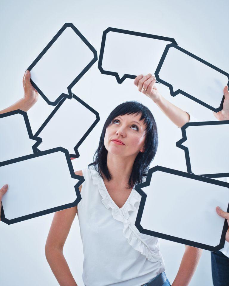 speech bubbles surround woman
