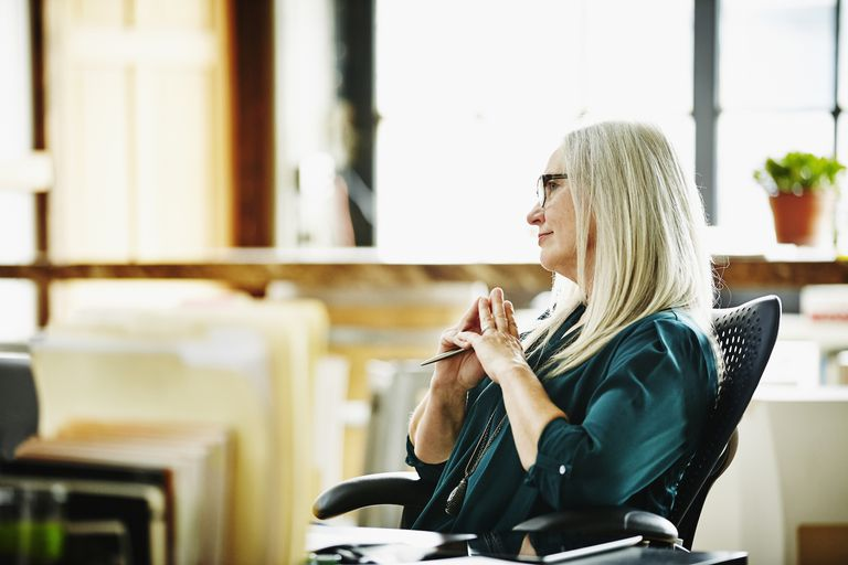 Mature woman listening during a business woman