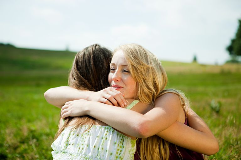 Young women embracing in a field