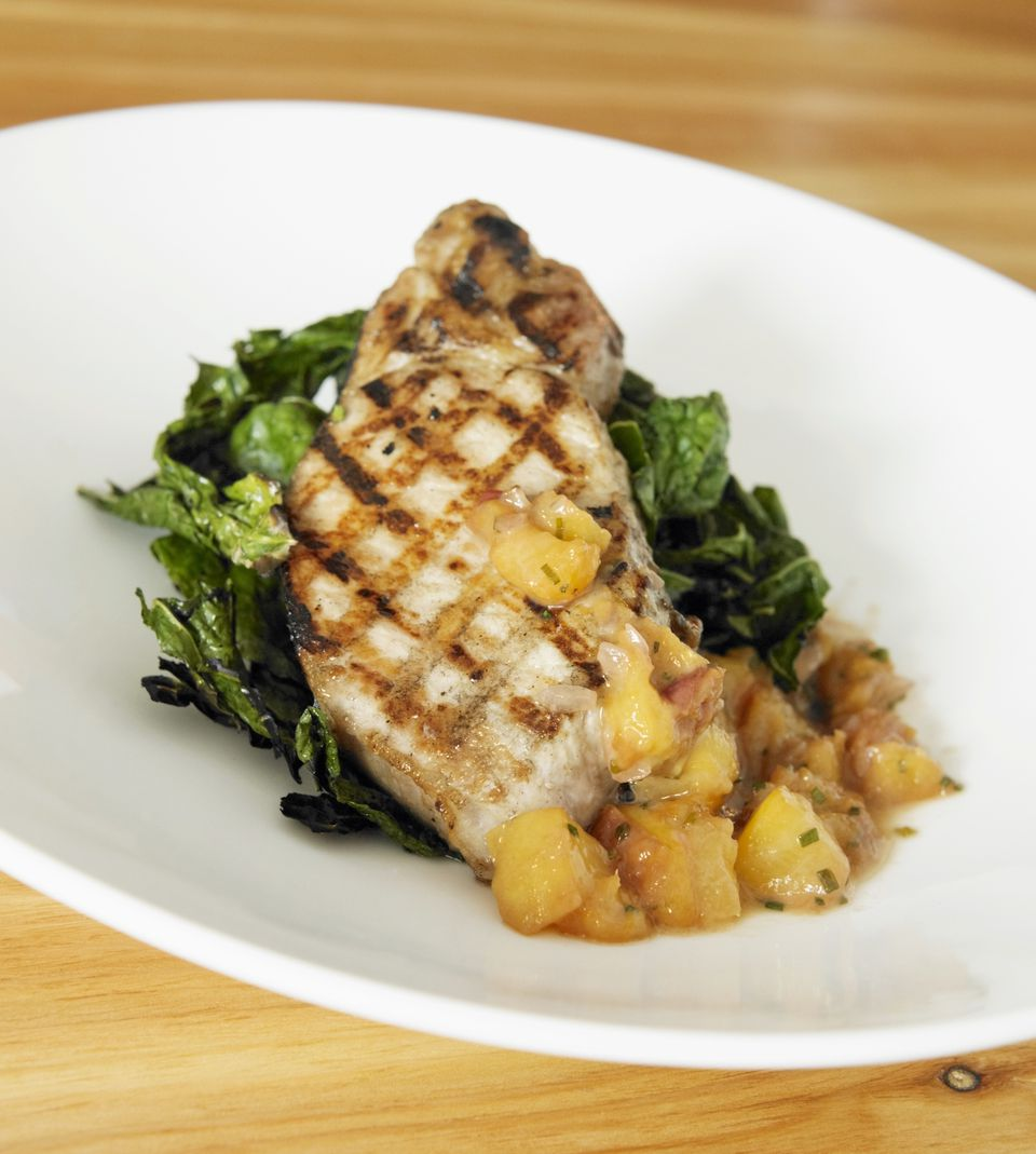 Grilled Pork Chop with Peach Chutney and Greens