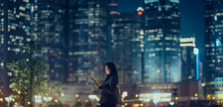 Woman using iPad outdoors