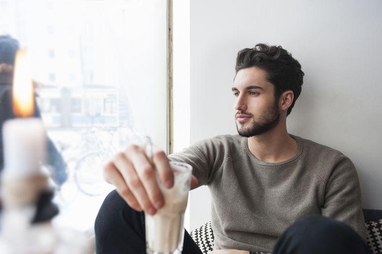 Young man relaxing, drinking milkshake