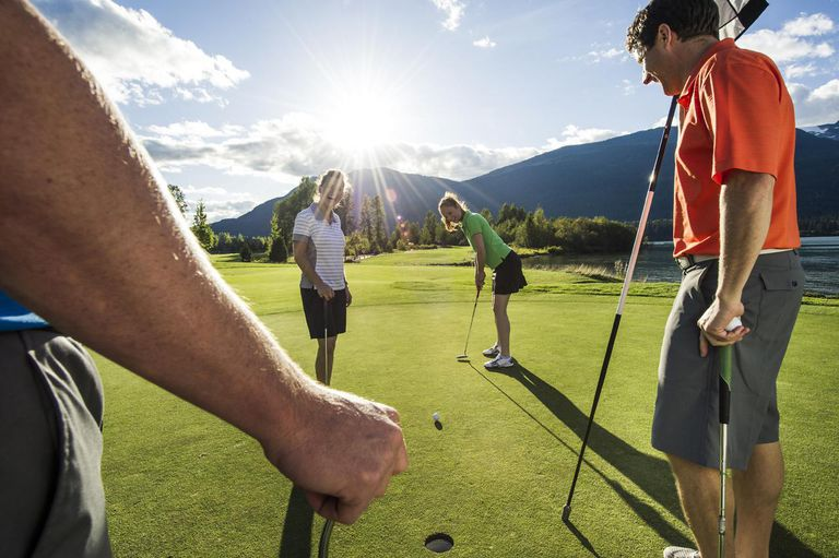 Friends playing golf