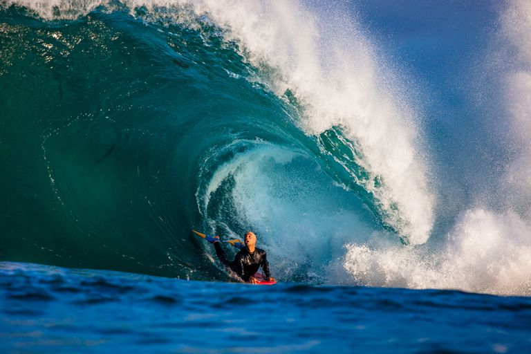 Man bodyboarding barrel wave, Australia