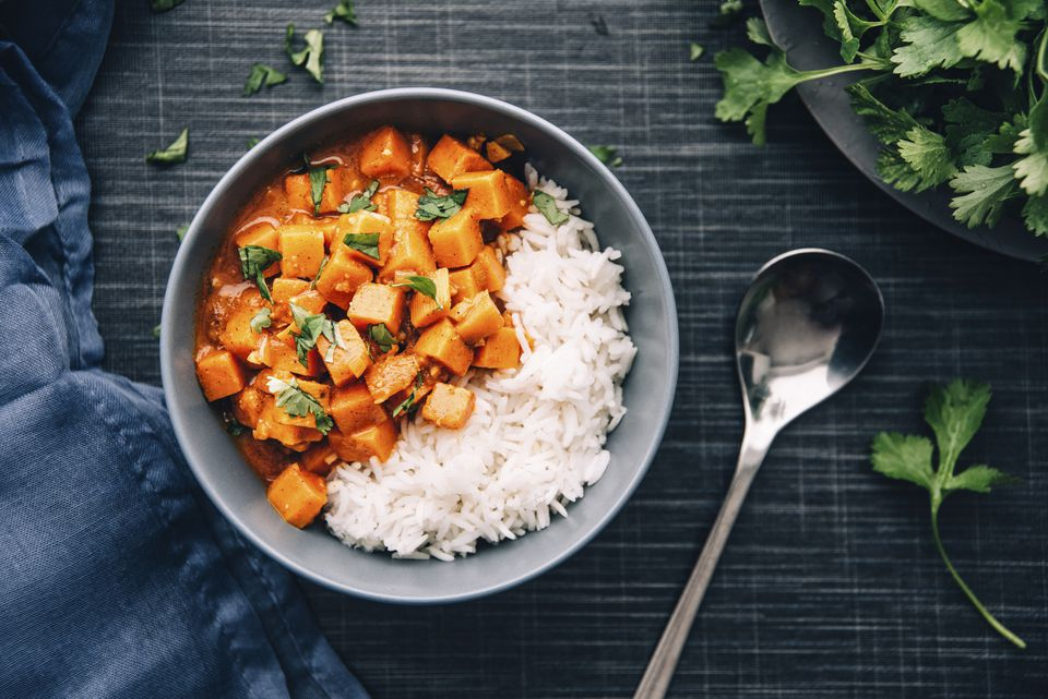 Bowl of sweetpotato ragout served with rice
