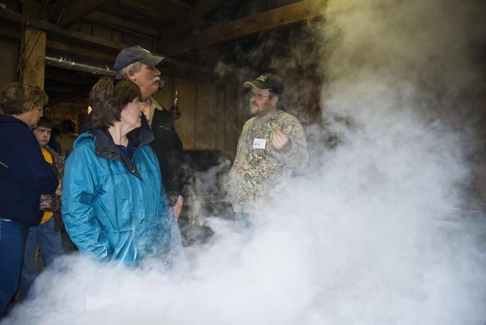 Visitors to Eagle's Sugar Camp in Highland County, Virginia, learn how maple syrup is made.
