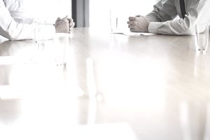two men at table for job interview