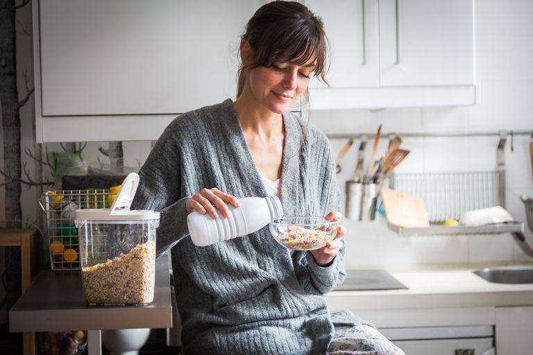 Food Woman eating muesli.
