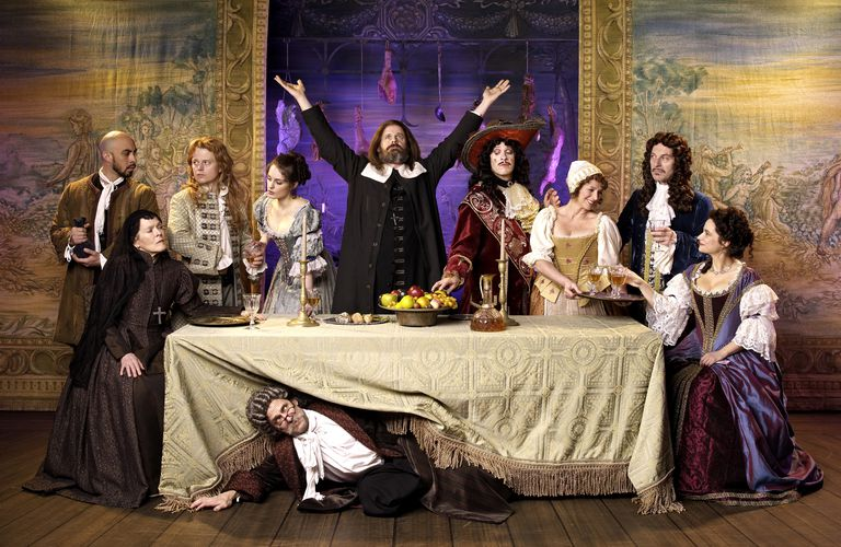 Actors in old-fashioned costumes on stage