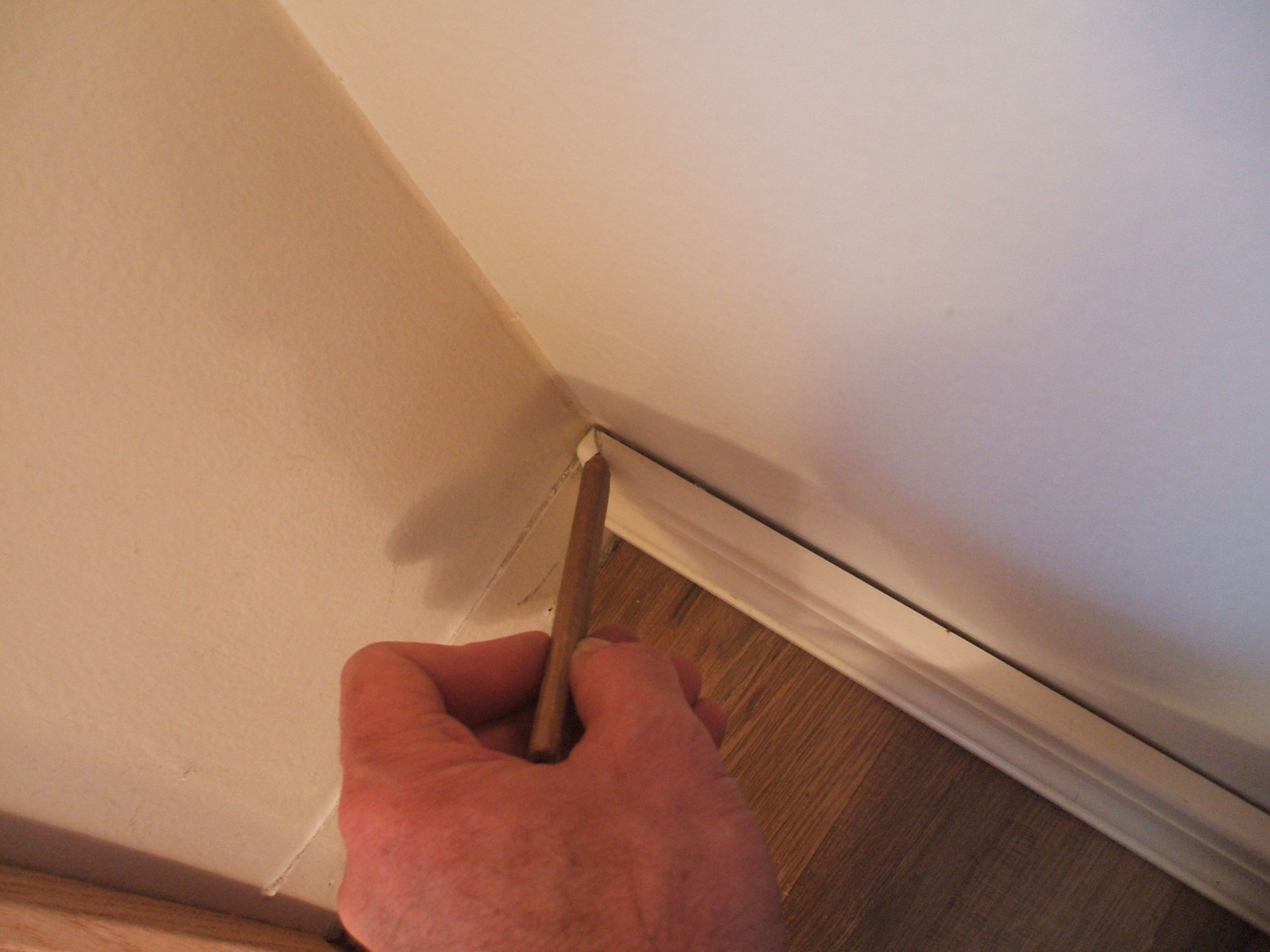 How to cut base molding around wall vent - Baseboard Woes Learn How To Install On Inside Corners Trim Molding