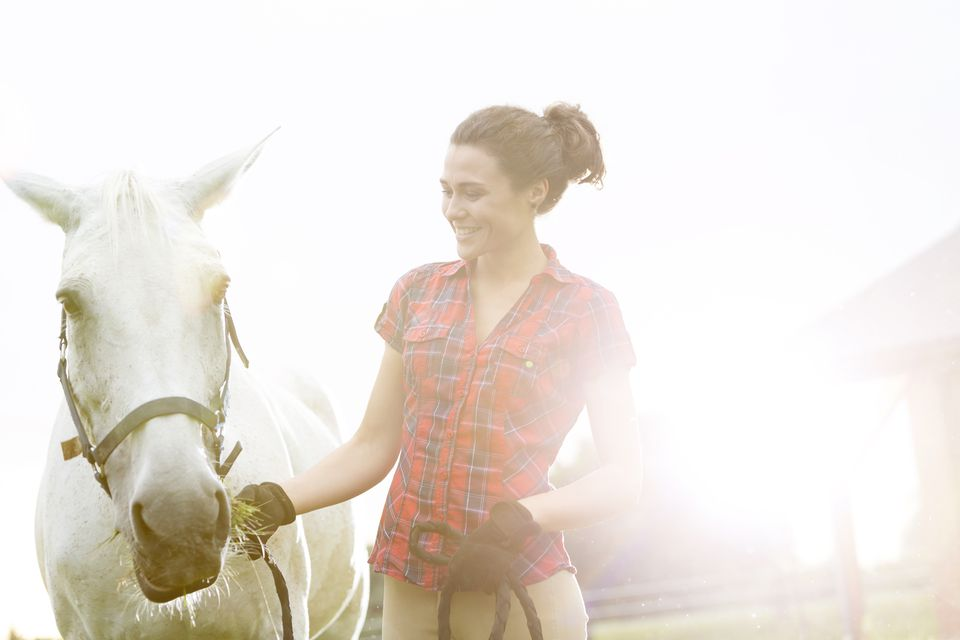 Smiling woman with horse