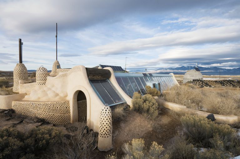 Adobe style self-sustainable solar and wind house made out of recycled materials
